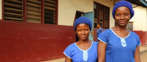 Mariama*, 17, and Martha*, 16, at school in Moyamba